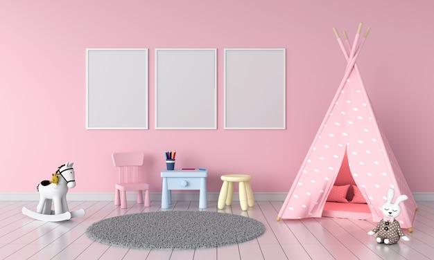 Três moldura vazia no quarto de crianças Foto Premium