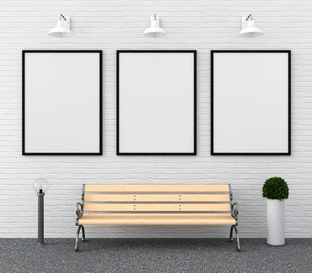 Três molduras em branco para maquete na parede Foto Premium