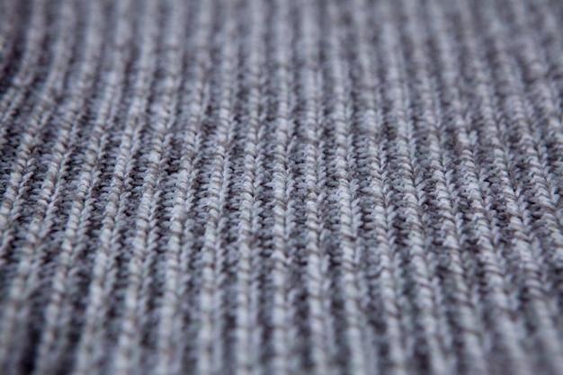 Tricô sem costura padrão. fundo de lã cinza. malha artesanal velha Foto Premium