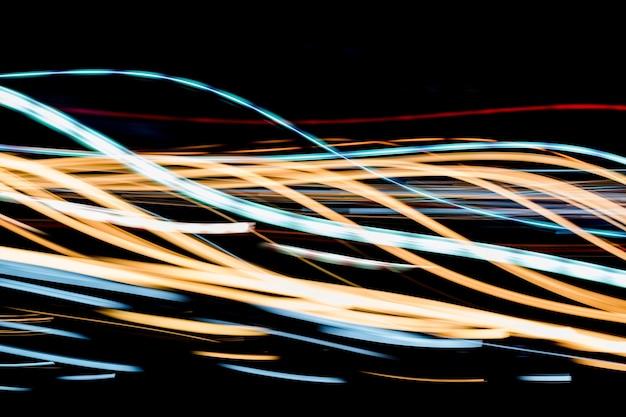 Trilhas de luz abstrata à noite Foto Premium