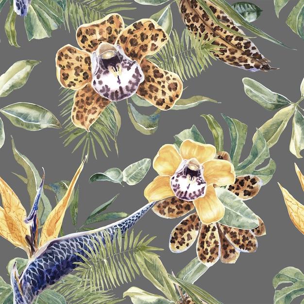 Tropical padrão sem emenda com flores exóticas e folhas de palmeira Foto Premium