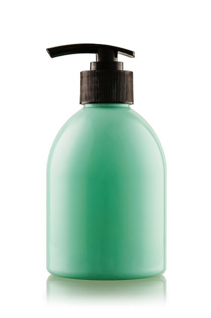 Turquesa garrafa de sabonete líquido ou gel com uma bomba em um branco isolado Foto Premium