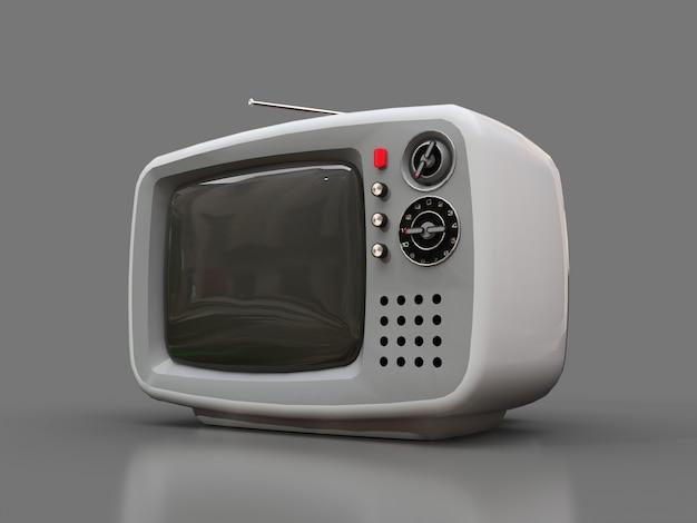 Tv branca velha bonita com antena em um fundo cinza Foto Premium