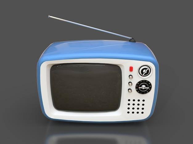 Tv velha azul bonito com antena em uma superfície cinza Foto Premium