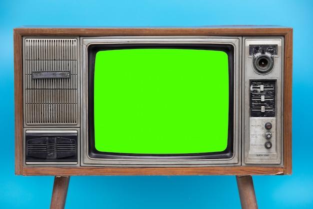 Tv vintage isolado no fundo azul. Foto Premium