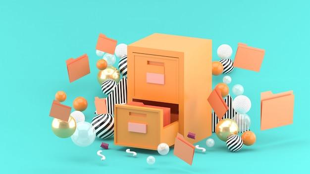 Um armário de documentos cercado por bolas coloridas em azul. renderização em 3d. Foto Premium
