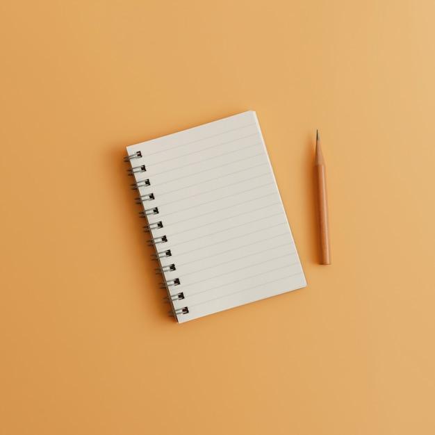 Um bloco de notas em branco com o lápis no fundo marrom da cor com espaço da cópia. estoque conservado em estoque para meios sociais. Foto Premium