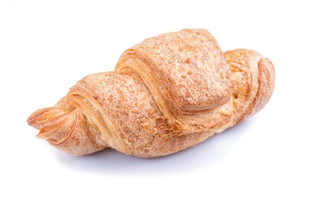 Um croissant isolado no branco Foto Premium