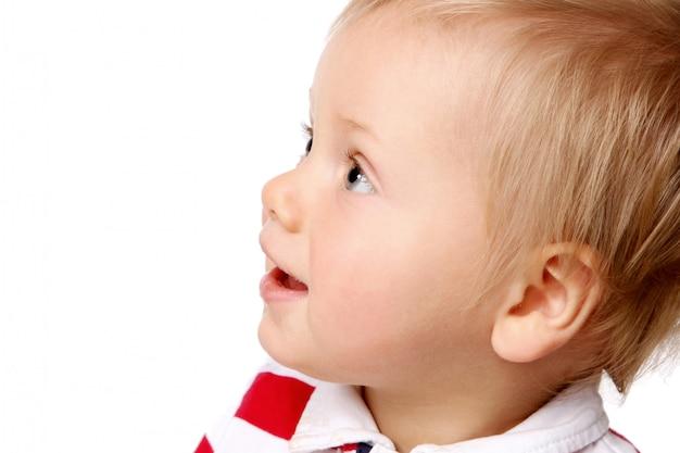 Um pequeno garoto funy em branco Foto gratuita