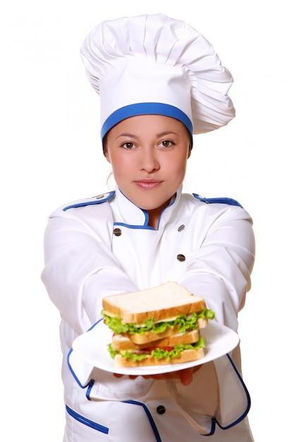Um youg e belo chef com sorriso Foto gratuita