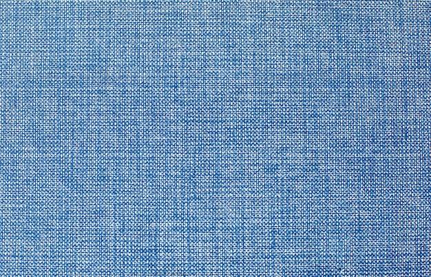 Uma capa de livro de pano vintage com um fundo azul Foto Premium