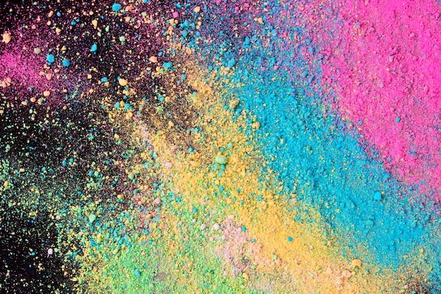 Uma explosão do pó colorido do pigmento no fundo preto. Foto Premium