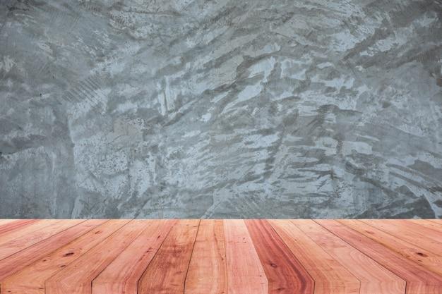 Uma foto de uma mesa de madeira na frente de um fundo desfocado abstrato de um cimento polido Foto Premium