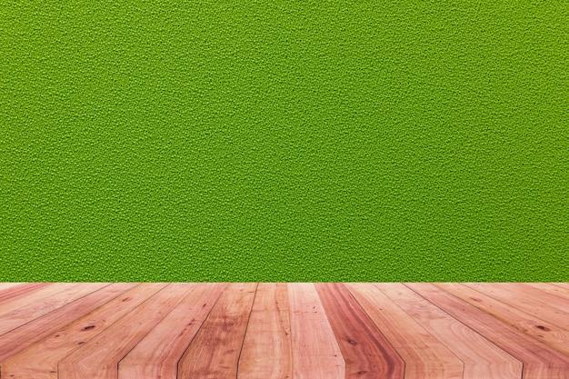 Uma imagem de uma mesa de madeira na frente de um fundo abstrato do pano verde. Foto Premium
