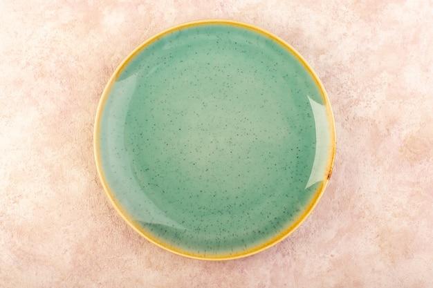Uma placa verde vazia vista de cima redonda em forma de mesa de refeição isolada Foto gratuita