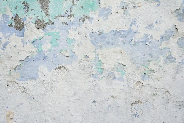 Uma textura de parede pintada velha e resistida adequada para o fundo de obras de arte Foto Premium