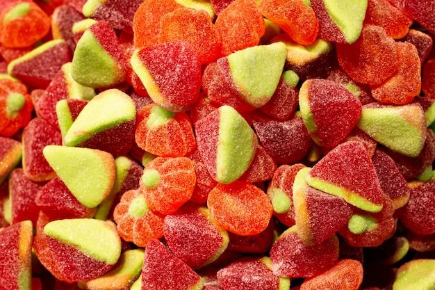 Uma variedade de doces de geléia vista do topo, fundo fechado. textura de close-up de doces açucarados Foto Premium