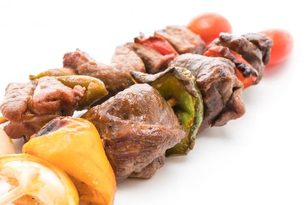 Vara de churrasco de carne grelhada Foto gratuita