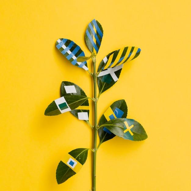 Variedade de desenhos de ficus folhas fundo amarelo Foto gratuita