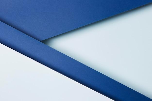 Variedade de fundo de folhas de papel azul Foto Premium