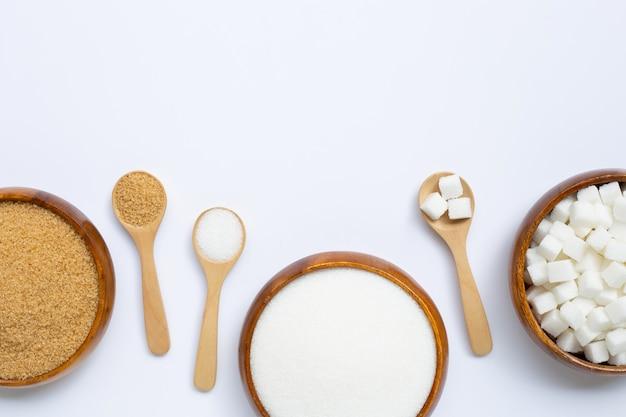 Vários tipos de açúcar. vista superior flay lay Foto Premium