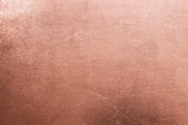Velho latão ou fundo de cobre, textura de um meta laranja vintage Foto Premium