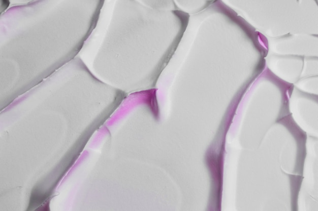 Velho textura rachada fundo branco com mancha rosa Foto gratuita
