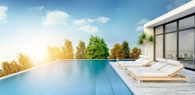 Verão, salão de praia, espreguiçadeiras no deck para banhos de sol e piscina privada Foto Premium
