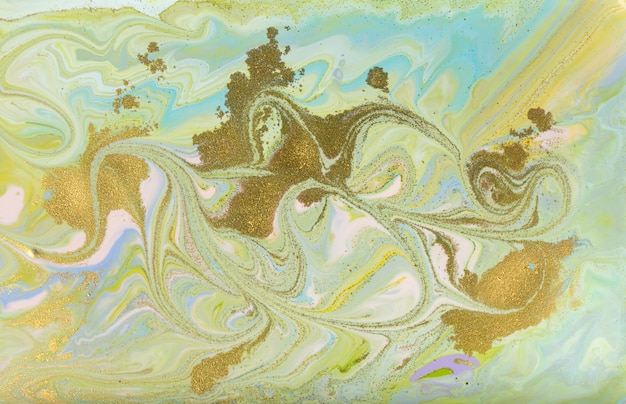 Verde e ouro derramando pintura. pálido fundo bonito. Foto Premium