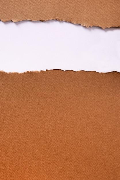 Vertical de fundo do cabeçalho de tira de papel marrom rasgado Foto gratuita