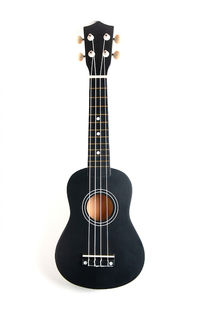 Violão ukulele preto no branco Foto Premium