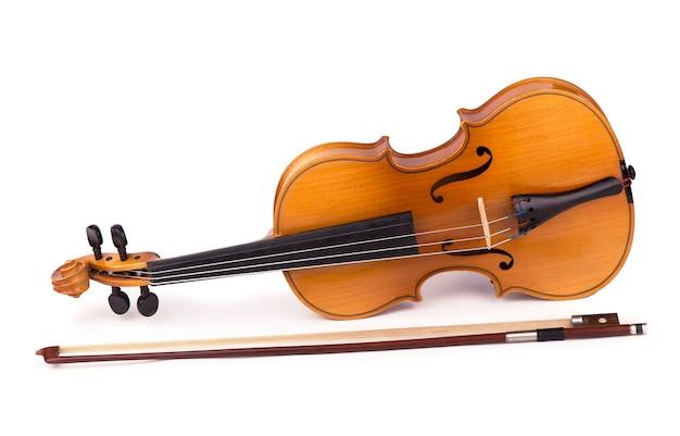 Violino e arco em fundo branco Foto Premium