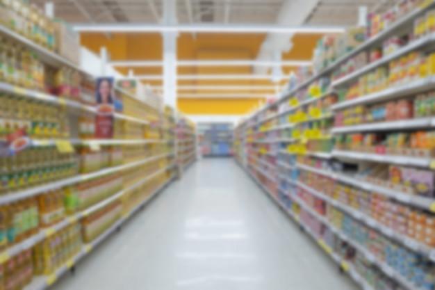 Vista de supermercado turva abstrata do corredor de supermercado vazio, desfocado fundo desfocado Foto Premium