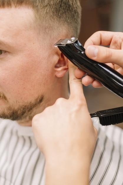 Vista do close-up do conceito de barbearia Foto gratuita