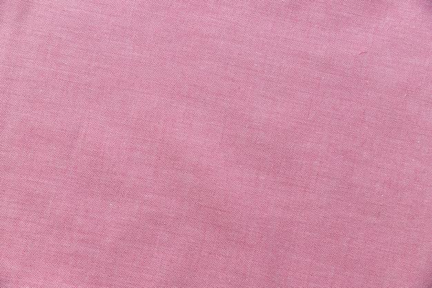 Vista elevada, de, cor-de-rosa, têxtil, fundo Foto gratuita
