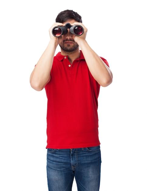 Vista frontal da adolescente segurando seus binóculos Foto gratuita