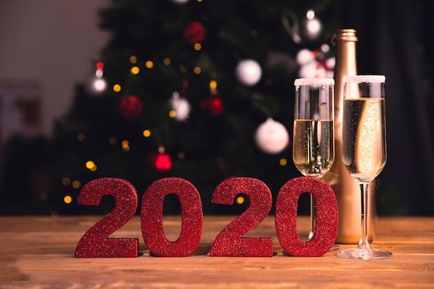 Vista frontal preparativos para a festa de ano novo Foto gratuita