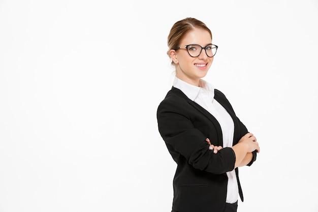 Vista lateral da mulher de negócios loira sorridente em óculos Foto gratuita