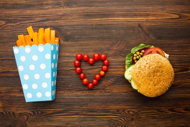 Vista superior amor vegan fast food Foto gratuita