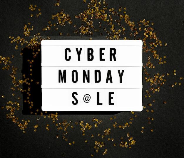 Vista superior da caixa de luz cibernética de segunda-feira com glitter dourado Foto gratuita