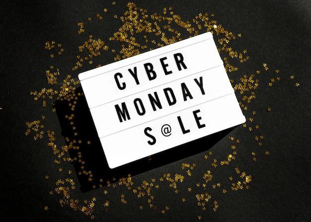 Vista superior da caixa de luz cibernética segunda-feira com glitter dourado Foto gratuita