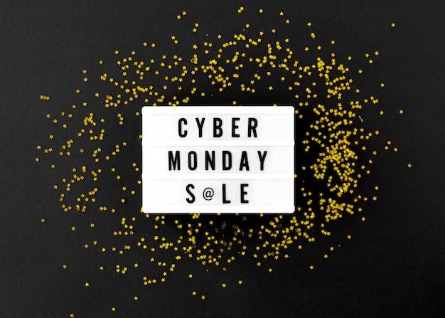 Vista superior da caixa de luz para cyber segunda-feira com glitter dourado Foto gratuita