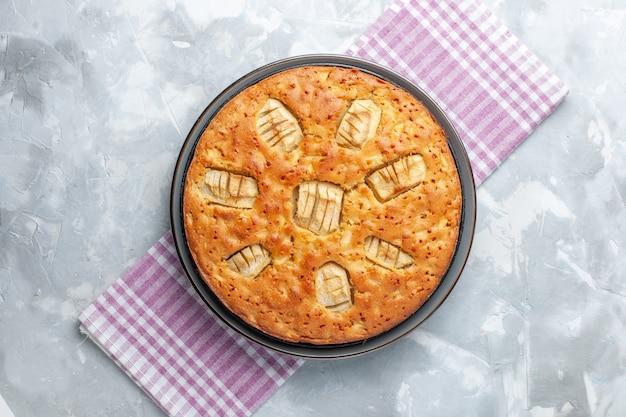 Vista superior deliciosa torta de maçã assada dentro da panela sobre superfície clara Foto gratuita