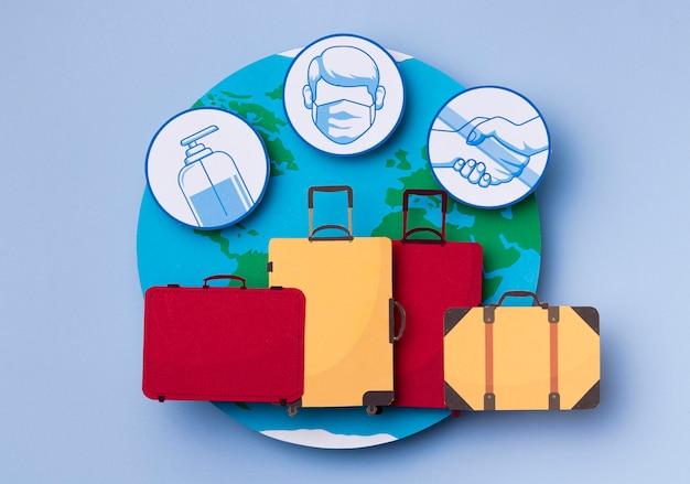 Vista superior do dia mundial do turismo com bagagem Foto gratuita