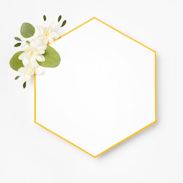 Vista superior elegante moldura dourada com folhas Foto Premium