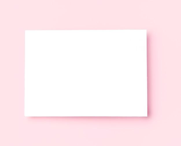 Vista superior moldura branca em fundo rosa Foto gratuita
