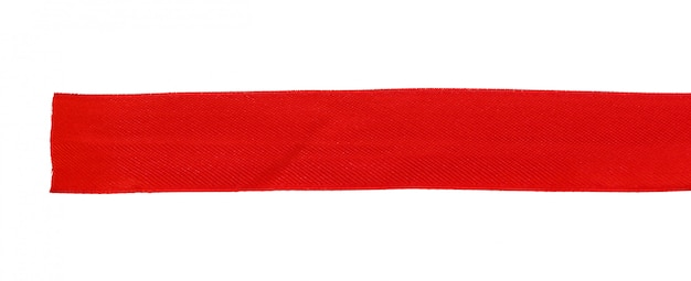 Vista superior próxima acima da fita vermelha isolada no branco. configuração plana Foto Premium