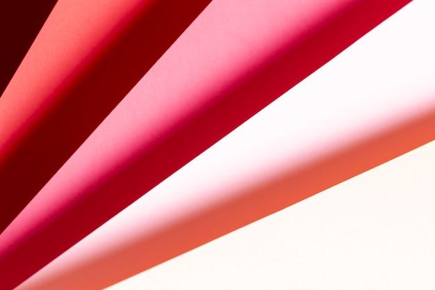 Vista superior tons de close-up de papéis vermelhos Foto gratuita