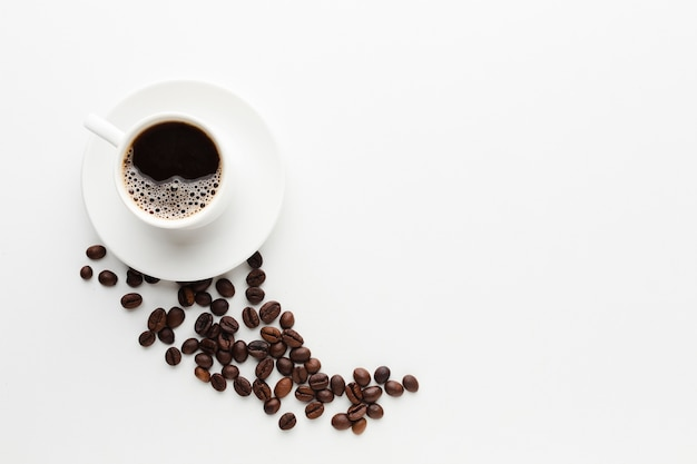 Vista superior xícara de café com espaço de cópia Foto gratuita