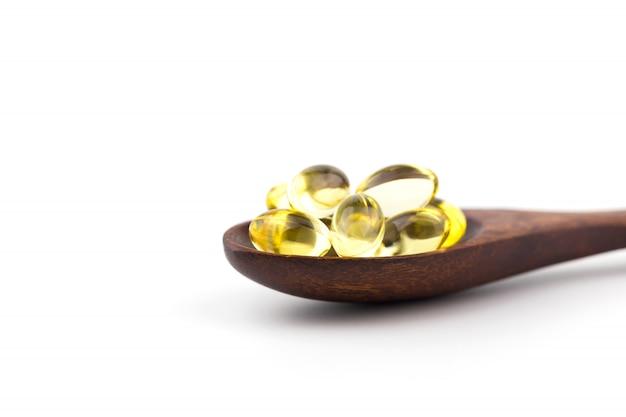 Vitaminas saudáveis no fundo branco Foto Premium